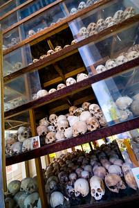 Layer upon layer of skulls collected from mass graves at Choeung Ek Killing Fields - Phnom Penh Cambodia