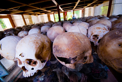 Rows of skulls collected from mass graves at Choeung Ek Killing Fields - Phnom Penh Cambodia