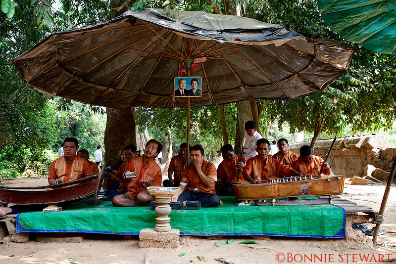 Cambodian land mine victims play for guests, and sell their music CDs, outside the Banteay Srei temple.