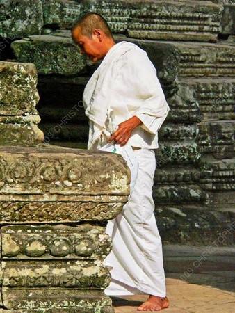 Cambodia - Siem Reap - Angkor - Angkor Thom - Bayon Temple - white-robed monk