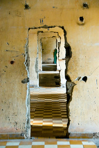 Battered doors leading through the torture rooms at the Tuol Sleng (S-21) Genocide Museum - Phnom Pehn, Cambodia