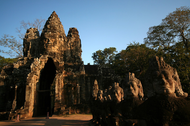 Dawn at the South Gate of Angkor Thom, with Asura figures lining the causeway at right.
