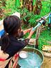 Cambodia - Siem Reap - Bampingreach - girl pumping water