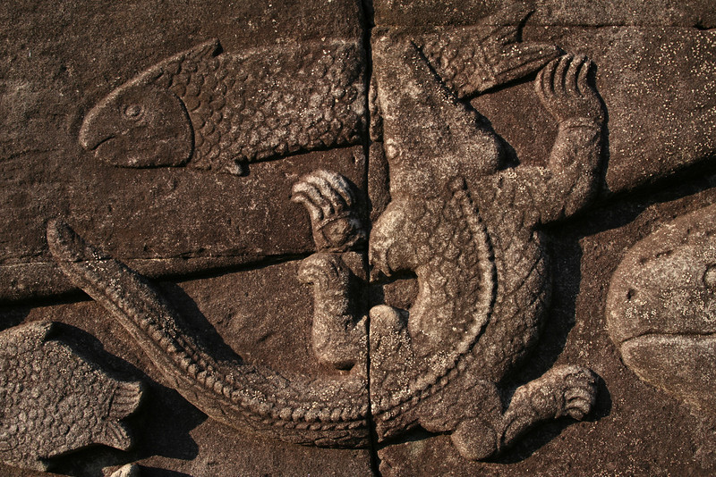 Wall relief of a crocodile devouring a fish, Bayon Temple, Angkor Thom, Siem Reap, Cambodia.