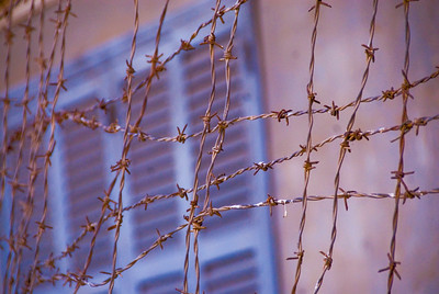 Barbed wire at the Tuol Sleng (S-21) Genocide Museum - Phnom Pehn, Cambodia