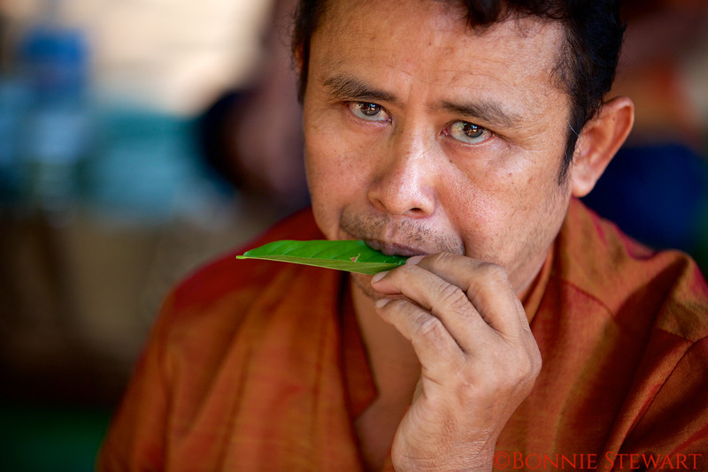 "Cambodian land mine victim plays his ""leaf"" instrument near Banteay Srei Temple"