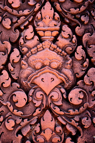 Detail of one of the exquisite relief carvings in red sandstone which adorn Banteay Srei Temple, Angkor, Cambodia.