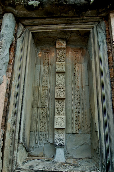 Beng Melea Temple. Carving on door. Unexcavated