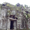 Cambodia - Siem Reap - Tomb Raider temple overgrown by forest -