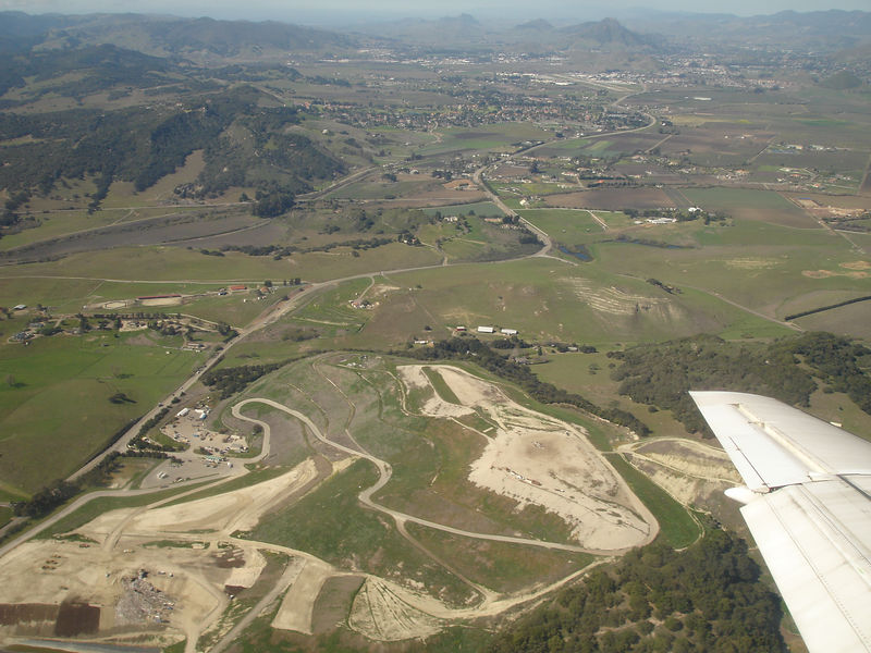 Approaching San Luis Obispo airport, the valley  is green in February. There are many very nice  homes on large lots.