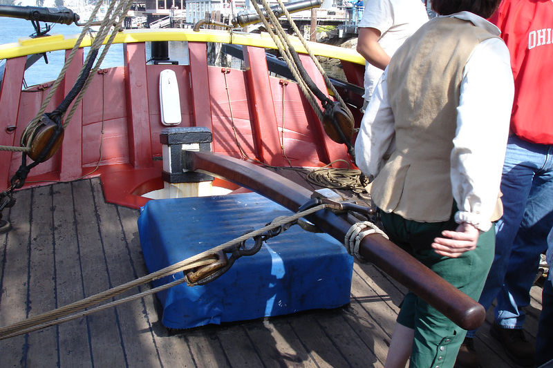 The ship uses a tiller rather than a wheel to control the rudder.