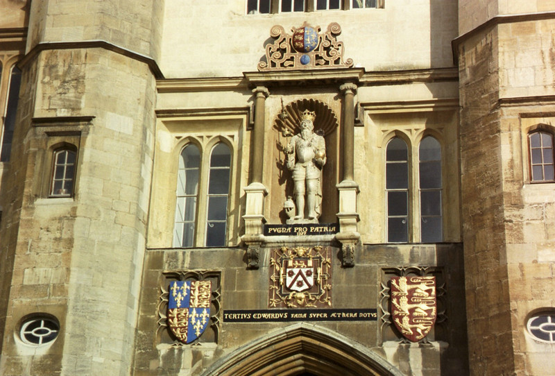 closeup of the entrance gate to Trinity College, Cambridge (showing Henry VIII holding a chair leg as a scepture)  - we would love to have your comments.