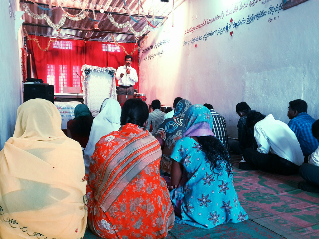 A minister delivers a Sunday Sermon at a small, concrete church on the outskirts of Hyderabad.