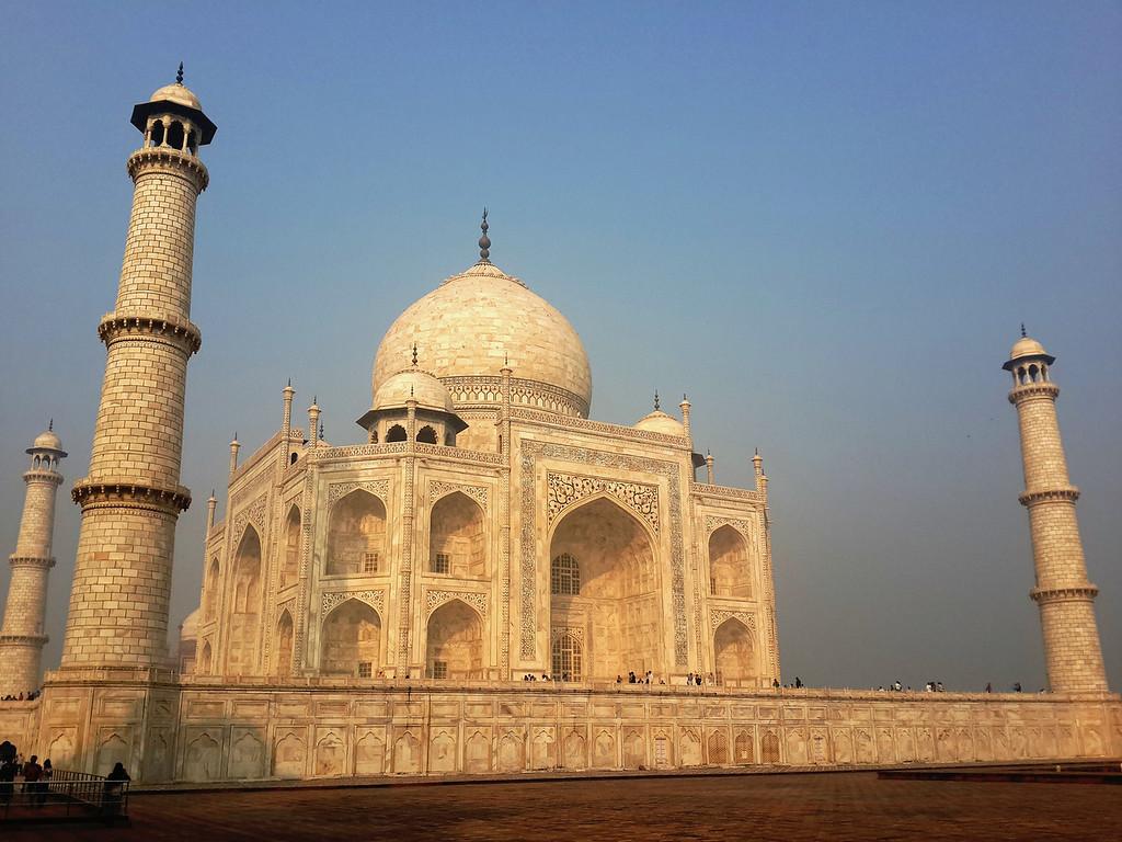 The Taj Mahal lights up after the haze subsides.