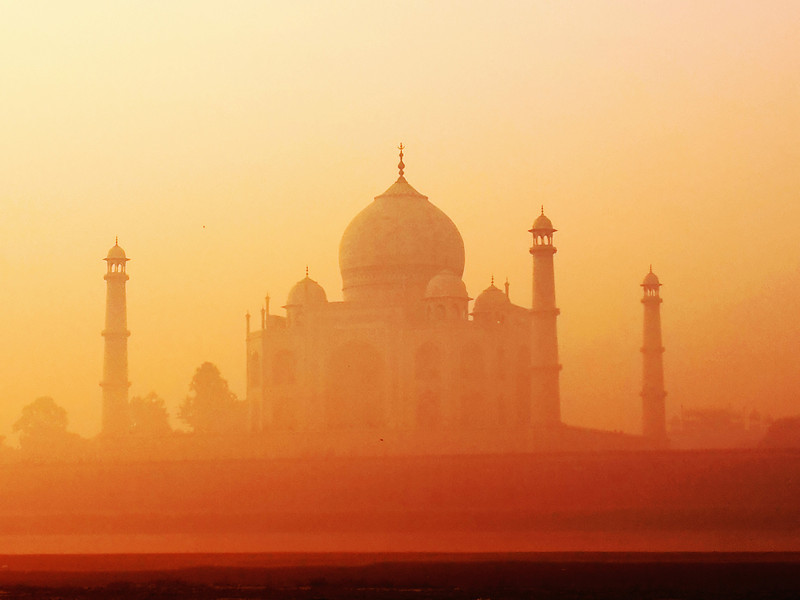 India's Crown Jewel, The Taj Mahal, glows as the rising sun shines on it's incredible facade.