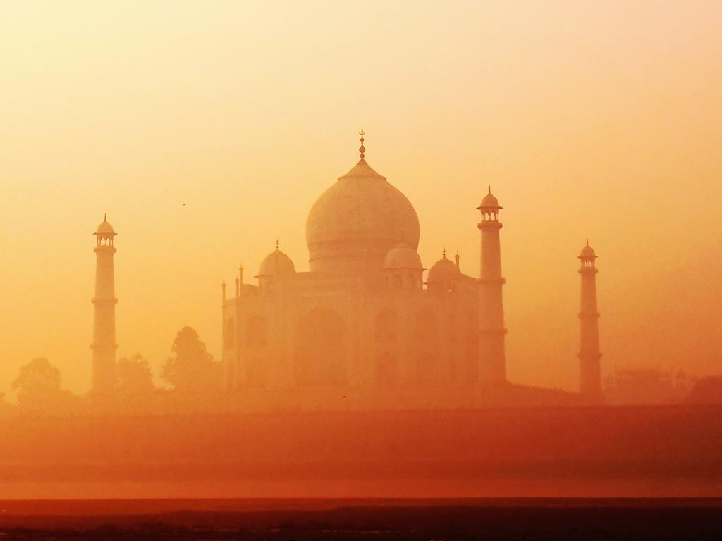 India's Crown Jewel, The Taj Mahal, glows as the rising sun shines on it's incredible facade.