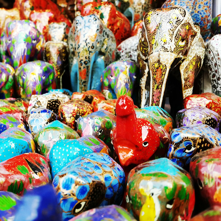 Elephant trinkets sit at a stall in a street market in New Delhi.
