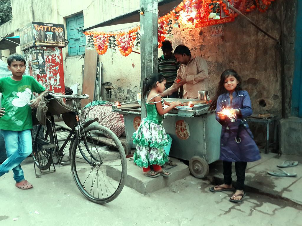 School girls celebrate Diwali with sparklers in New Delhi.