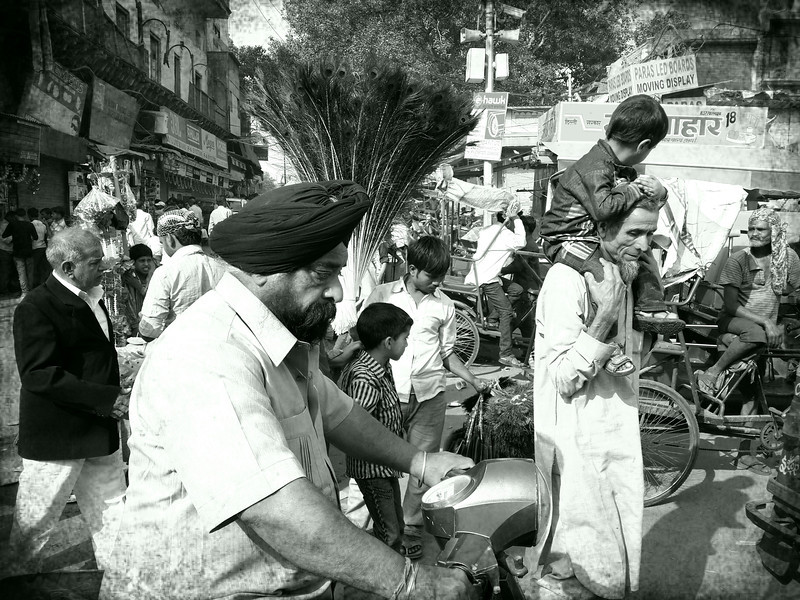 A typical street scene while riding a tuk tuk in old Delhi.