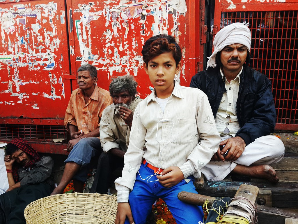 A boy posses for a photo with his accomplices in an Old Delhi street market.