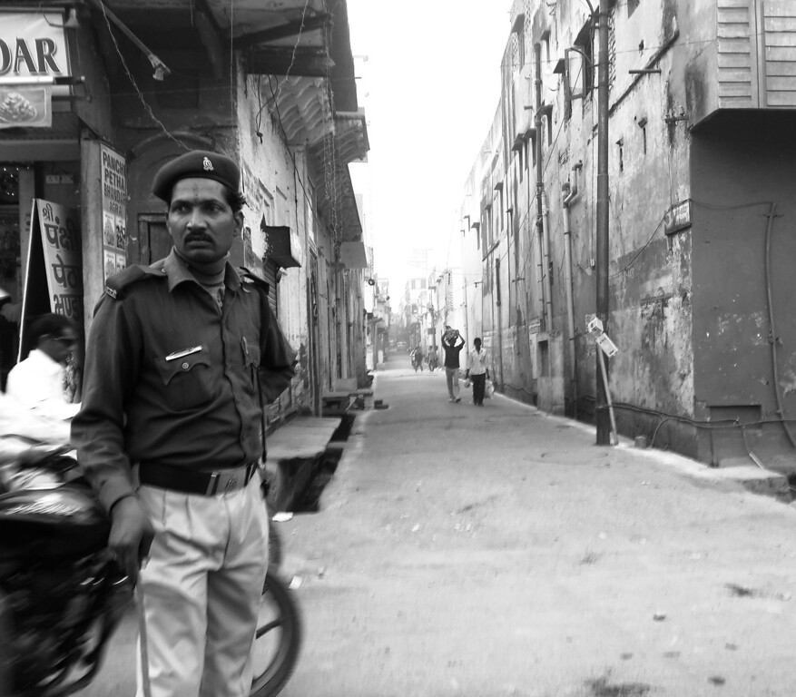 A police officer attempts to regain order among the chaos that is rush hour in Agra.