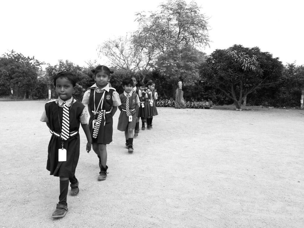 Students file into the classrooms after an outdoor lesson at the Good Shepard School in Uddamarry