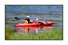Mother and child kayaking on the river near Granby Lake in Colorado.