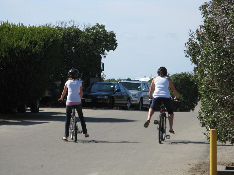 Aubrey and Marissa take a bike ride around the camp.