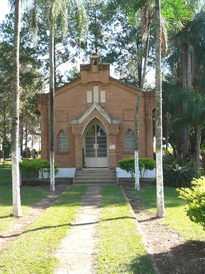 Palm trees line the path up to the chapel.