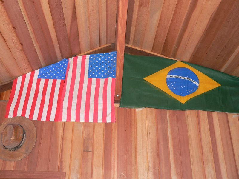 From the museum rafters hangs the flags of the United States and Brasil.