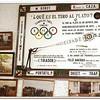 Skeet shooting club board and photos in corner of dining room,