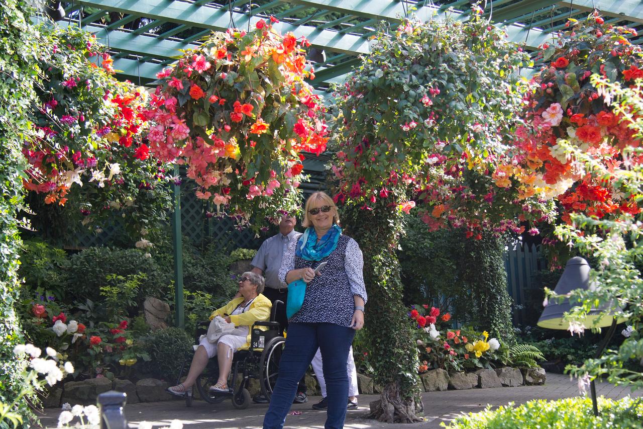 Vicki with hanging plants