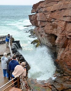 We visited Thunder Hole in Acadia National Park. The water comes in very quickly.  In less than a second it would fill the inlet and shoot into the air.
