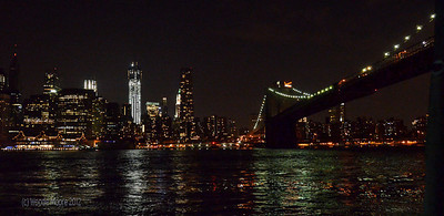 The skyline of lower Manhattan and the end of the Brooklyn Bridge.