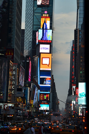 Times square on Saturday evening.  The billboard signs on the building rent for $10,000,000 a year.  That's about 70,000,000 a year from the signs.  Good thing because there is only one renter in the entire building--the city of NY rents space for the police substation on the first floor.  Notice the crystal ball at the top that falls at midnight each New Year's Eve.