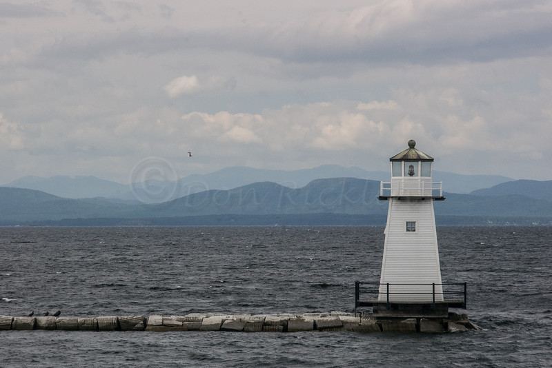 Lighthouse at the end of protectinve harbor jetty, Burlington, VT.