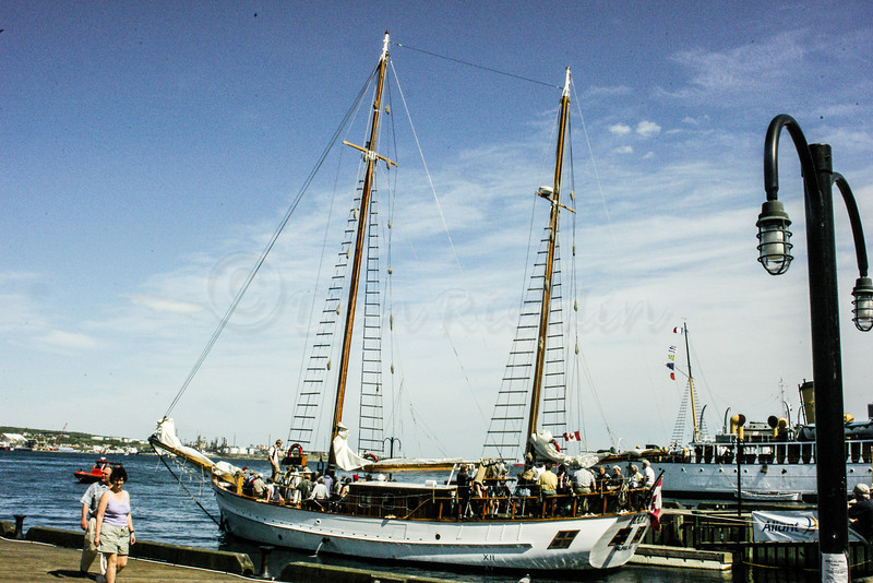 Two masted sloop in the harbor.