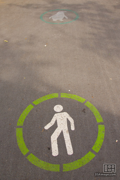 People and Penguin walking signs, Stanley Park, Vancouver