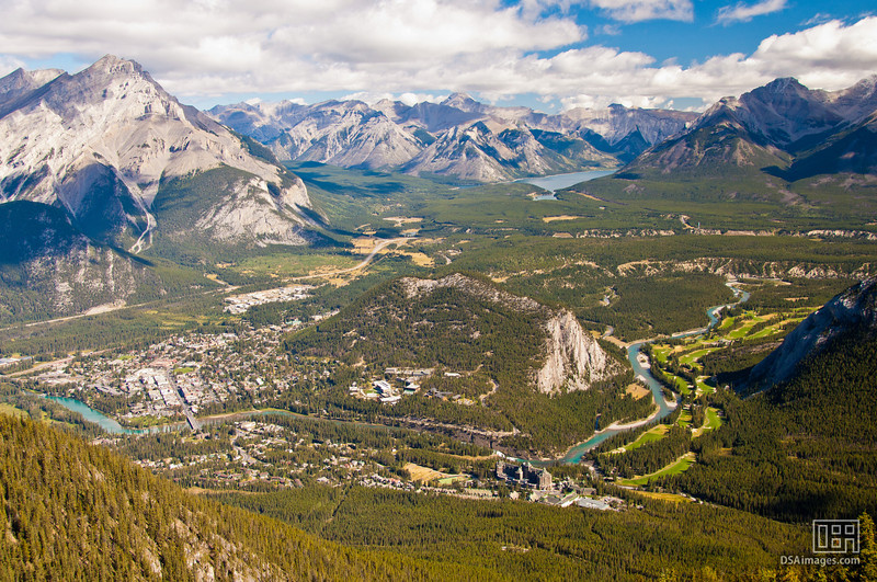 The town of Banff to the left, Cascade Mountain on the left, the Bow River snaking past the Fairmont Banff Springs Hotel at the bottom and Lake Minnewanka at the far back
