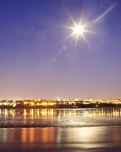 the full moon shines over Riviere du Loup, Quebec Province