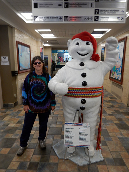 Michelene with Quebec Mascot, at the Tourist Information center