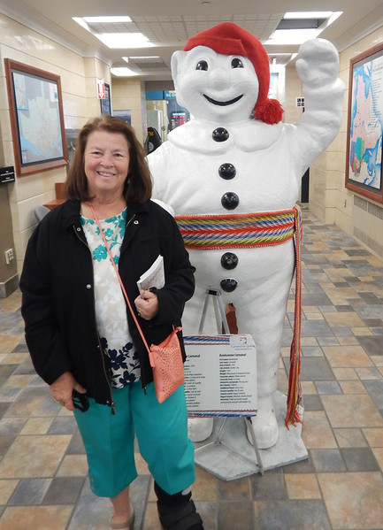 Janine with Quebec Mascot, at the Tourist Information center