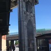 cool-looking cathedral door mural on overpass pillar