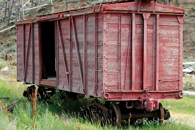 Abandoned red freight car, Alberta badlands.