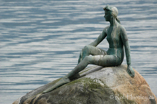Girl in a Wetsuit statue in Stanley Park, Vancouver, British Columbia.