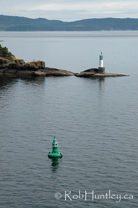 Lighthouse on the rocky shore.