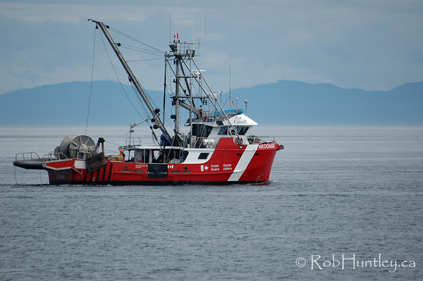 Canadian Coast Guard Vessel CCGS NEOCALIGUS, a near-shore fishery research vessel of the Department of Fisheries and Oceans. Near Victoria, British Columbia. © Rob Huntley