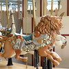 Butchart Gardens Carousel: ostrich with snake, and lion with monkeys