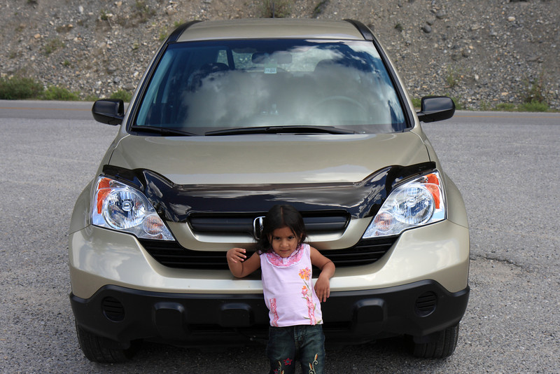 Sakshi with our Honda CR-V parked on Icefield Pathway
