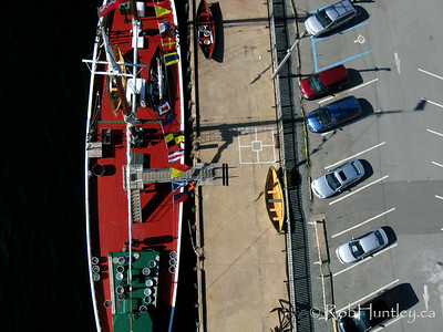 Overhead shot of a boat tied up at the wharf of the Fisheries Museum of the Atlantic in Lunenburg, Nova Scotia, Canada. This picture was taken from a camera rig suspended below a kite (Kite Aerial Photography - KAP). © Rob Huntley